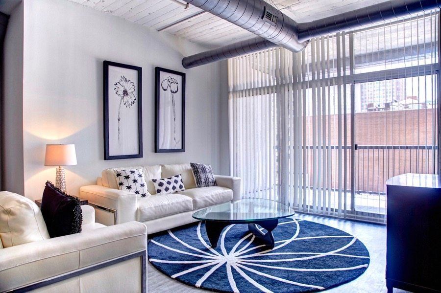 222 Saratoga Apartments Loft Style In Baltimore Md Living Room Model Apartment