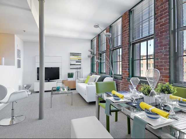 watch-factory-lofts-apartments-waltham-ma-living-room-and-dining-area